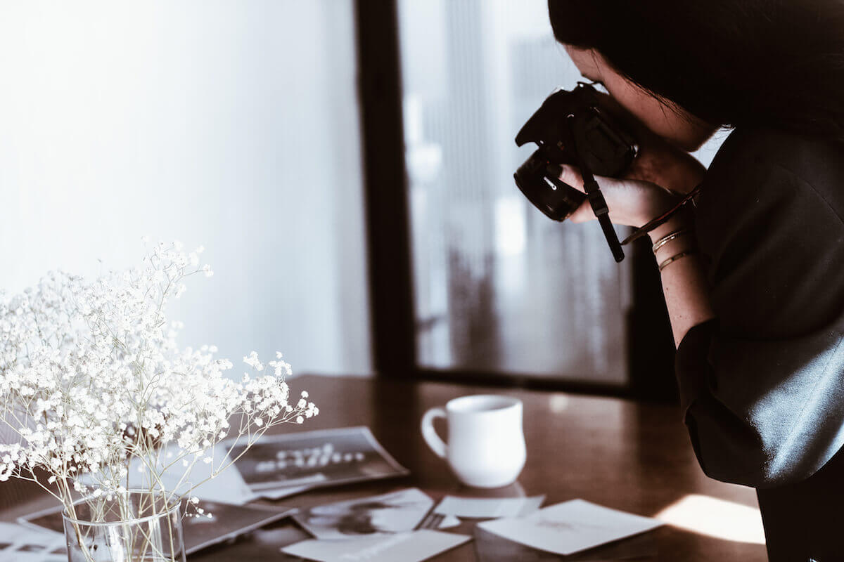 woman photographer at design table