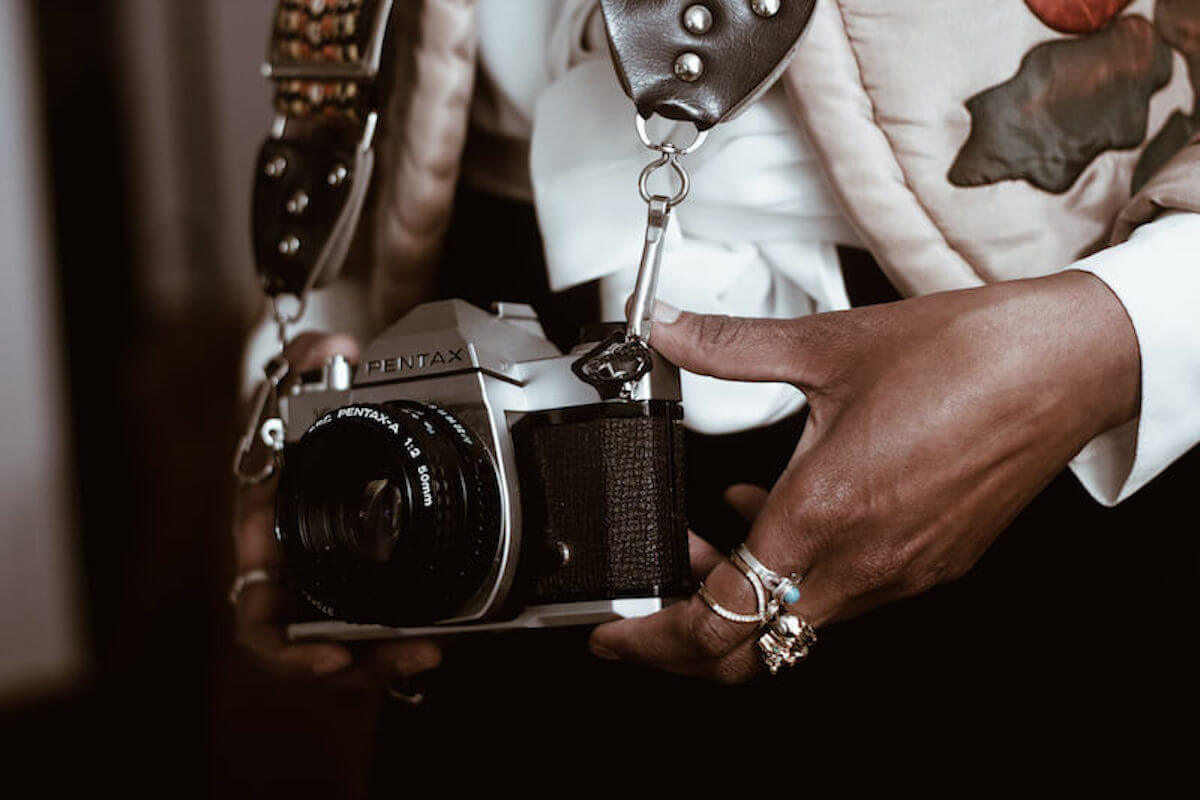 woman holding vintage camera